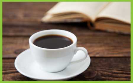 Cup of coffee and a library book
