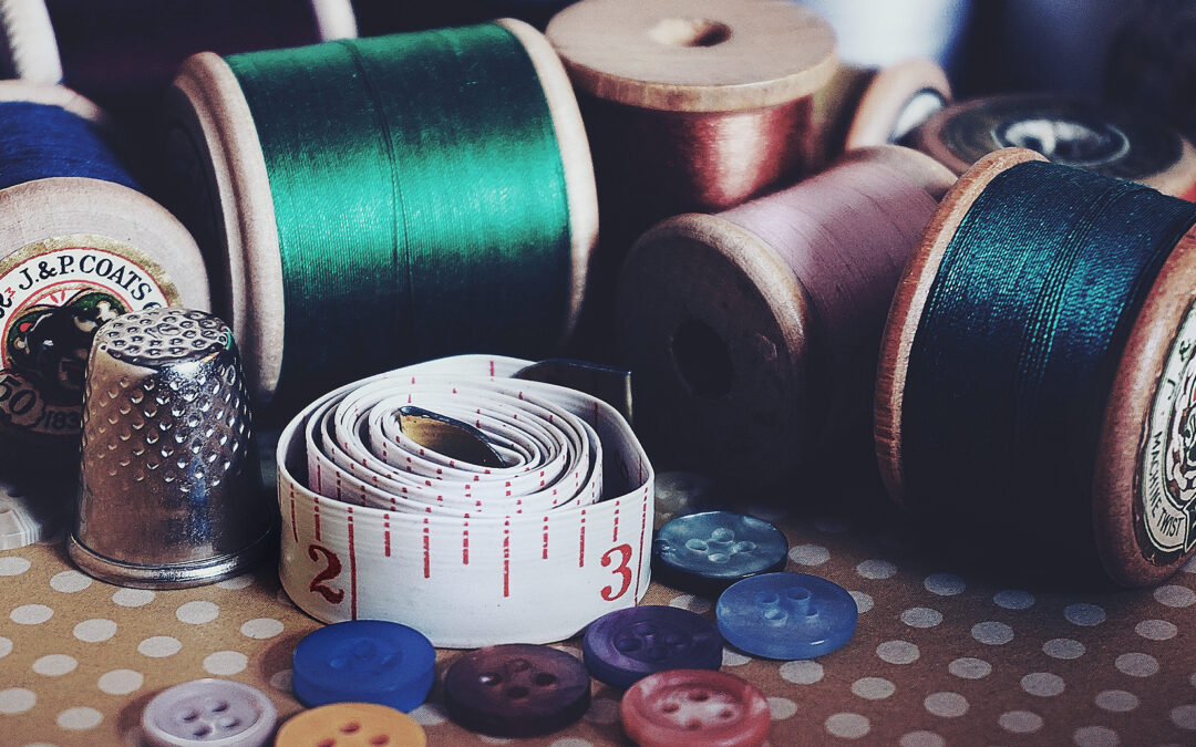 Pic showing rolls of thread, buttons and tape measure