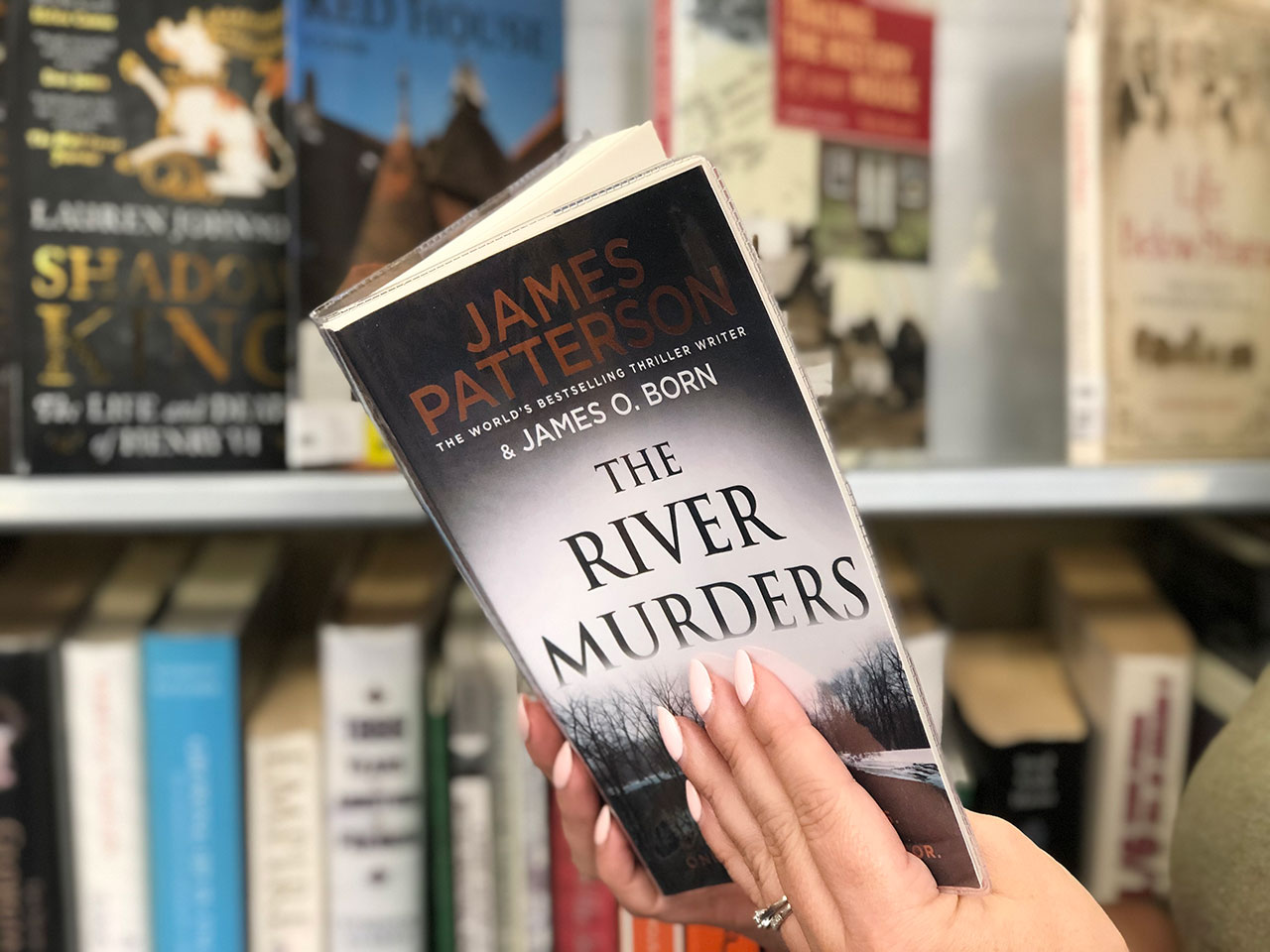 pic with hands holding James Patterson book